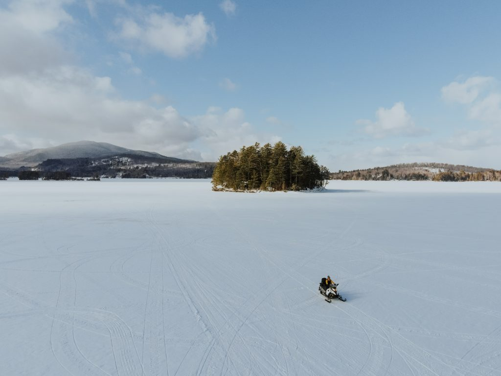 Drone shot of Snowmobiling on Moosehead Lake in Maine